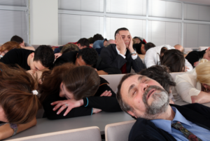 People sleeping during a presentation